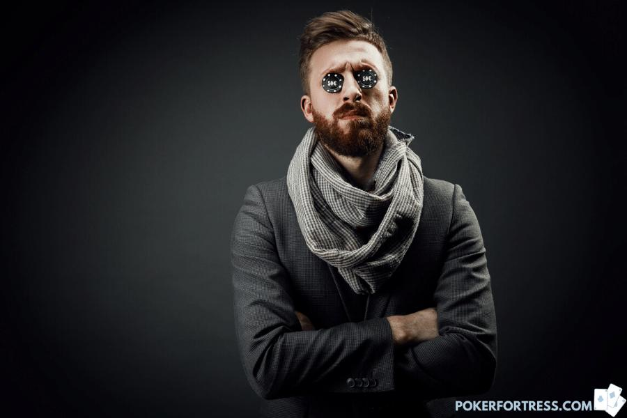 Poker player with scarf and poker chips.