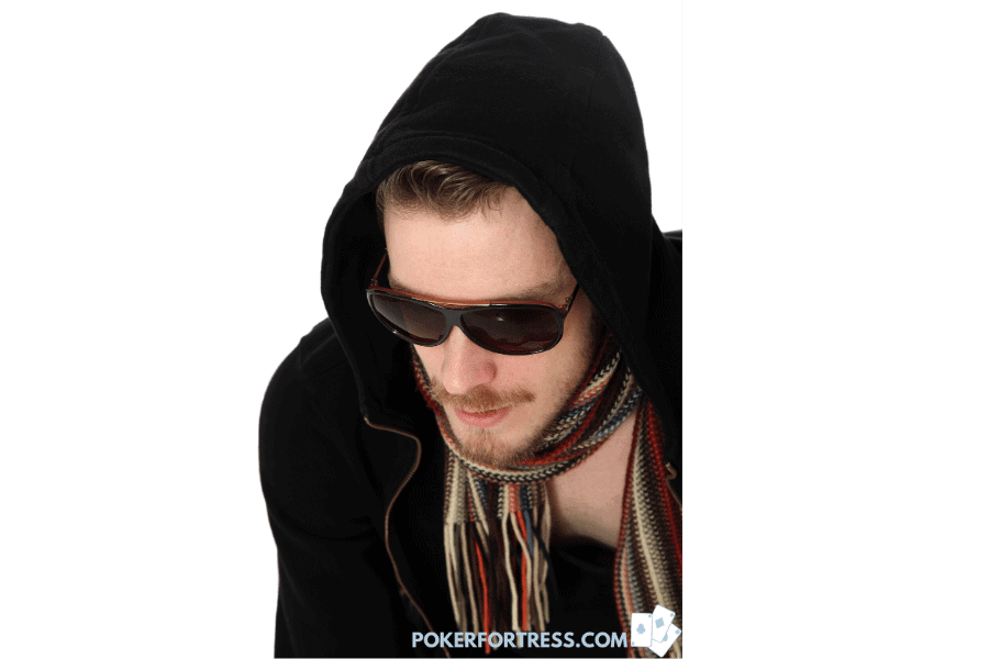 Poker player wear scarf, sunglasses and a hoodie.