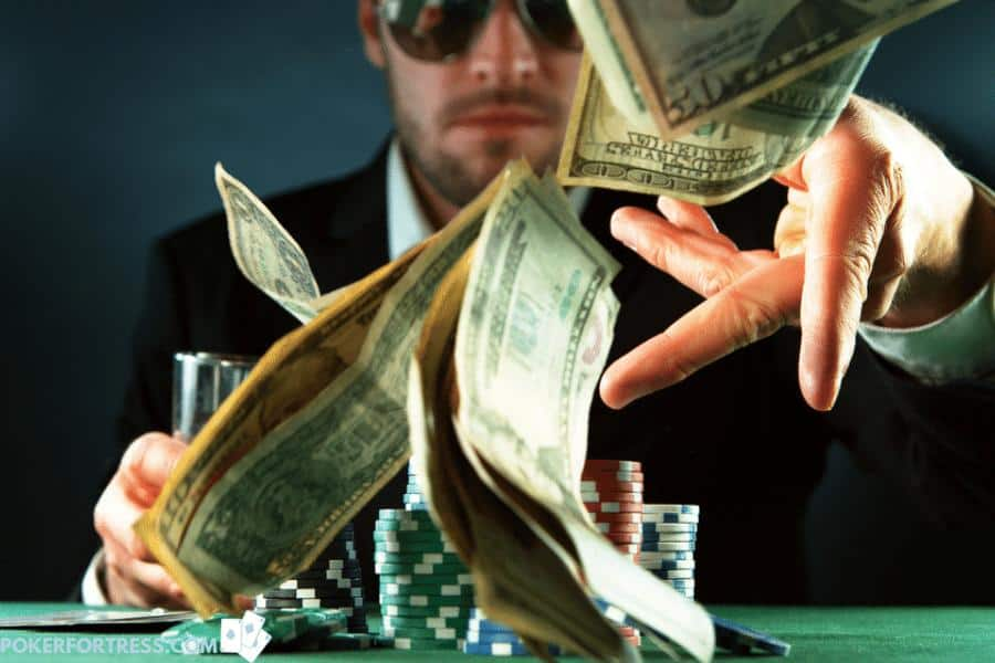 Placing bets in poker with real money.
