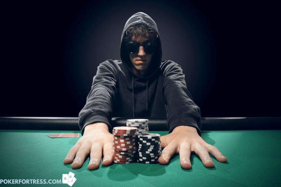 Player going all-in and out of poker chips.