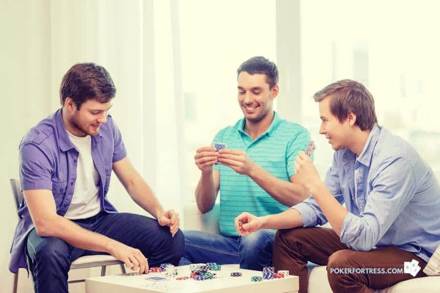 playing stud poker at home with friends